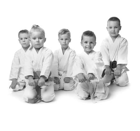 Little children in kimonos on white background