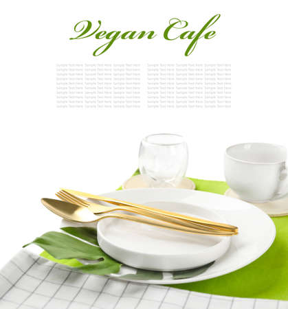 Table setting and text VEGAN CAFE on white background Stock Photo