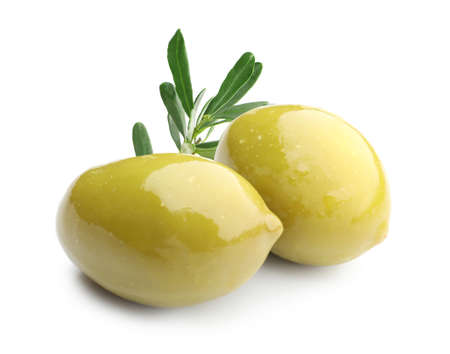 Ripe olives with leaves on white background