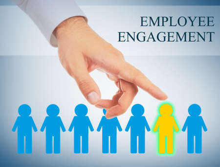 Man pointing on human icon against light background. Concept of employee engagement Stock Photo