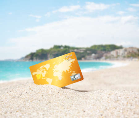 Credit card on tropical beach Stock Photo