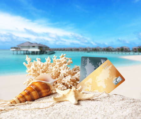 Composition with credit cards on tropical beach