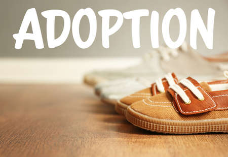 Adoption concept. Shoes of family on floor