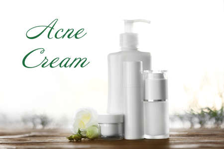 Beauty and skin care concept. Acne medication cosmetic on wooden table Stock Photo