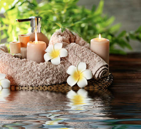 Beautiful spa composition with reflection on water surface Stock Photo