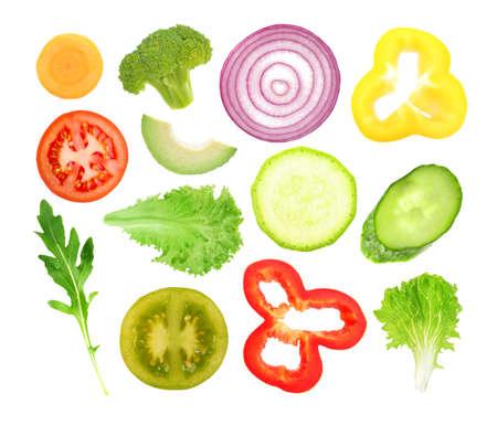 Vegetables slices on white background