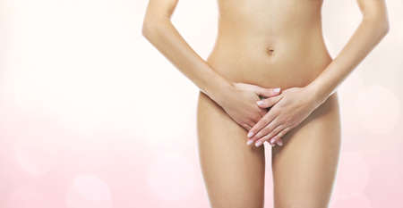 Gynecology concept. Young woman on color background
