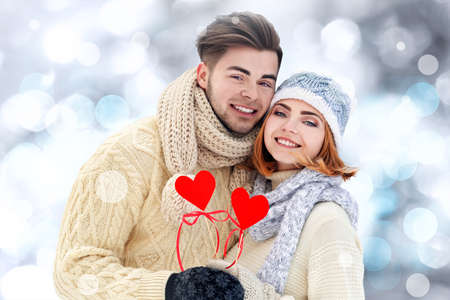 Beautiful young couple on blurred background
