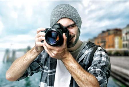Photographer taking picture of beautiful cityscape Archivio Fotografico