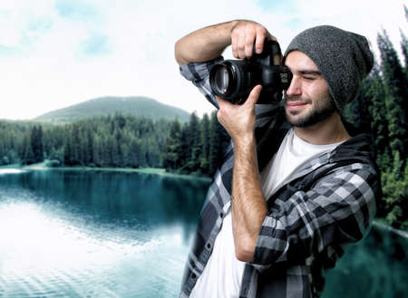 Photographer taking picture of beautiful landscape Stock Photo