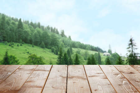 Wooden surface on beautiful landscape background 版權商用圖片