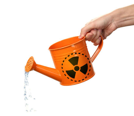 Environmental pollution concept. Woman pouring toxic water from can against white background