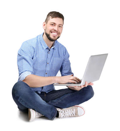 Handsome programmer with laptop on white background