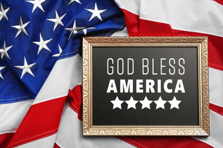 Frame with text GOD BLESS AMERICA on USA flag background
