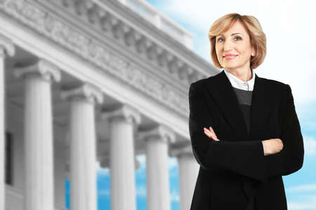 Law and justice concept. Senior woman on courthouse background Stock Photo