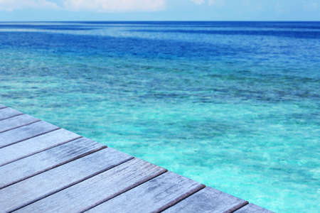 Wooden surface on beautiful seascape background