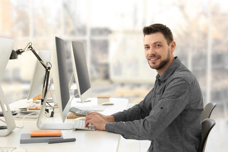 Programmer working in office