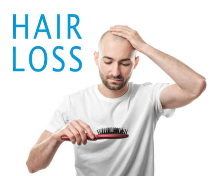 Hair loss concept. Man with brush on white background Stockfoto