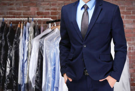 Dry cleaning concept. Businessman on blurred background Imagens
