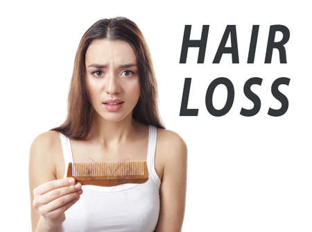Hair loss concept. Young woman with comb on white background