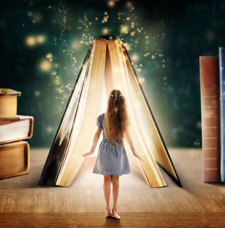 Adventure story and fairy tale. Tiny girl and book with magic glowing on table