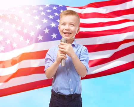 Little boy signing on USA flag background