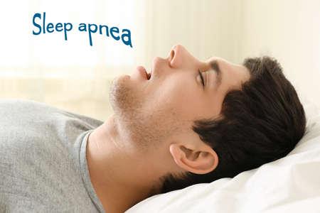 Obstructive sleep apnea concept. Young man snoring while sleeping