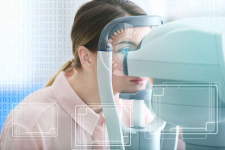 Young woman visiting an optician. Ophthalmologist concept
