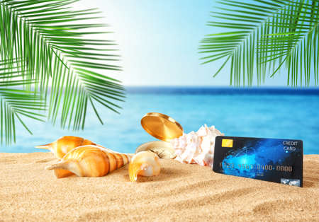 Travel concept. Credit card with seashells on landscape background
