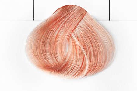 Strawberry blonde hair on white background Stock Photo