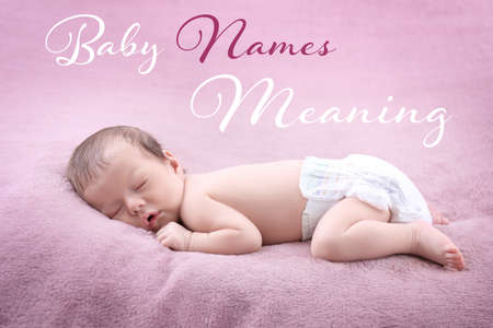 Concept of choosing baby names. Little child lying on plaid
