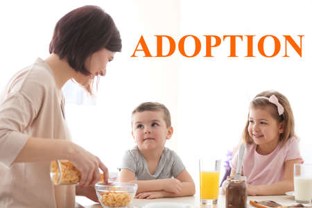 Adoption concept. Happy family having breakfast at home