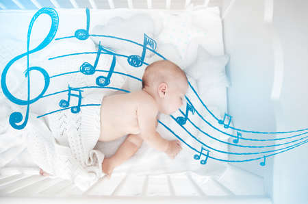 Cute baby sleeping in cradle. Lullaby songs and music concept