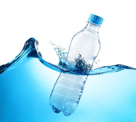 Bottle in water on white background. Concept of clean drink
