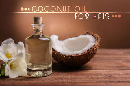 Coconut oil for hair. Cosmetic with flower and nut on color background