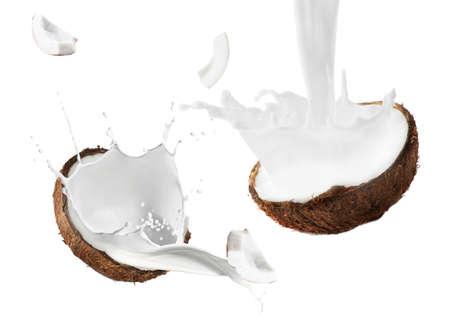 Coconut and milk splashes on white background