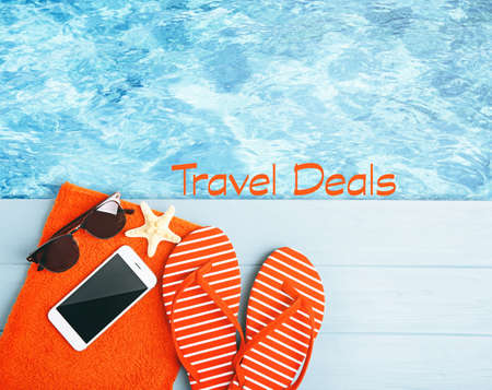 Travel deals concept. Stuff for vacation near swimming pool