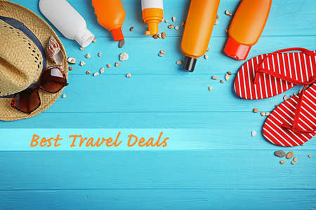 Travel deals concept. Stuff for vacation on wooden background