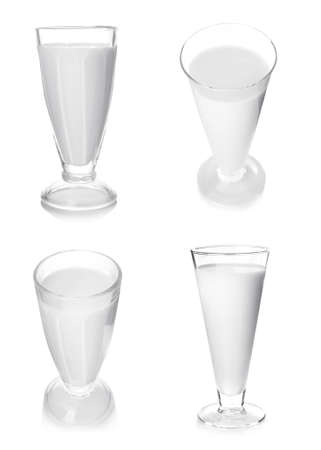 Glasses of fresh milk on white background