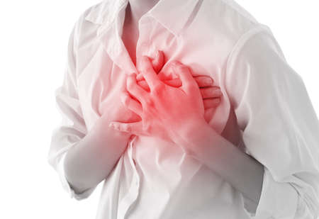 Heart attack concept. Woman suffering from chest pain, closeup
