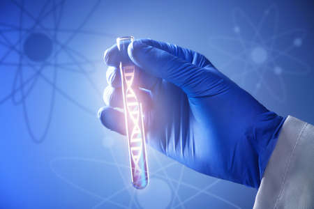 Scientific concept. Laboratory worker holding test tube with liquid on color background