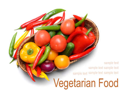 Vegetarian food concept. Fresh vegetables in basket on white background Stock Photo
