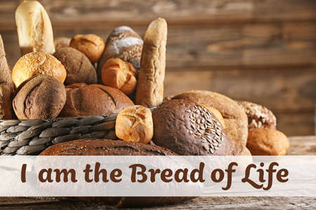 Assortment of bread and text on wooden background