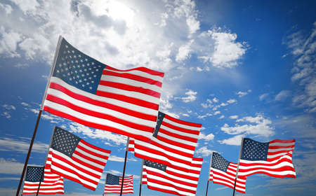 Waving USA flags on sky background. Patriotic concept