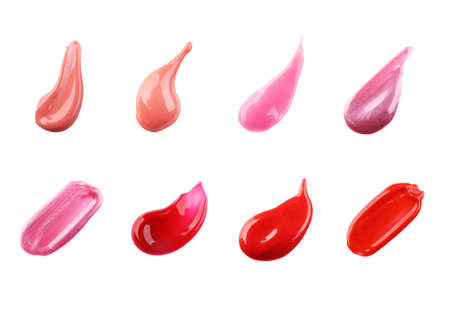 Samples of different color lip glosses on white background Stock Photo