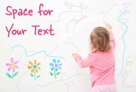Art concept. Cute little girl drawing on white background with space for design Imagens - 91532786