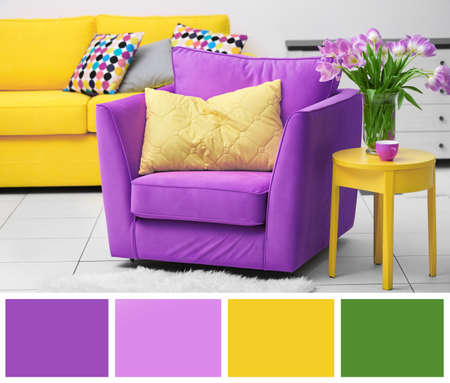 Lilac color accent in modern interior. Comfortable armchair and table with tulips in living room