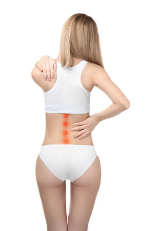 Concept of orthopedist. Woman suffering from pain in back on white background