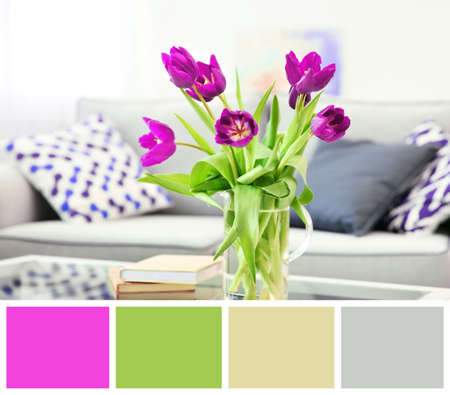 Lilac color accent in modern interior. Bouquet of tulips in vase on table