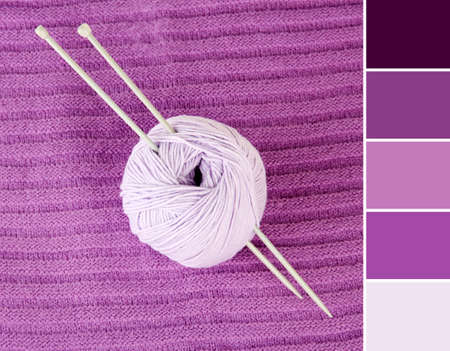 Color matching palette. Ball of yarn with needles on lilac textile background